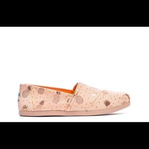 Brand new TOMS rose gold Pineapple
